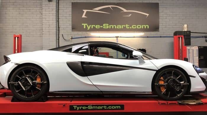 Tyre-Smart (Essex) Care on wheel alignment ramp