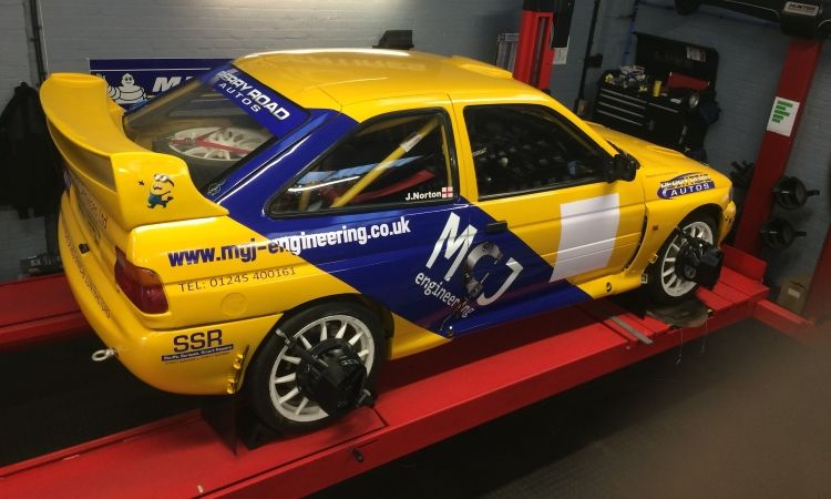 Escort Cosworth racing care on ramp for wheel alignment